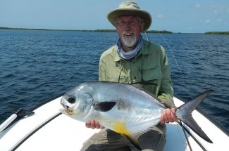 One lucky angler with his first permit on a fly