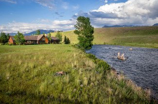 The lodge is located on the banks of the Madison River