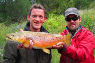 This angler is grinning big about this big brownie