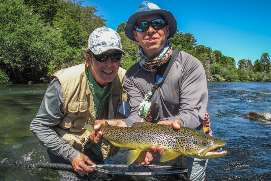 PRG guide Andres holds a nice brown that Walter landed fishing terrestrials on the Malleo