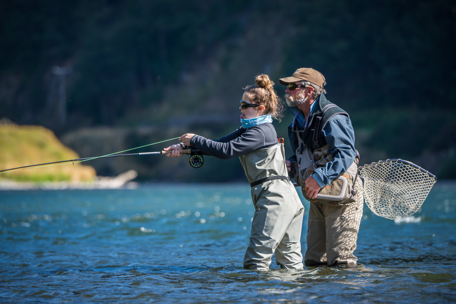Ella receives some coaching from the legendary Monte Becker on the Lower Simpson river