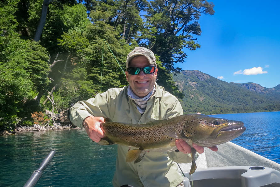 "Jason Cook with a big 29"" brown caught on Lago Tromen on day 1 of the trip!"